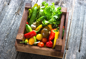 Delicious fresh vegetables in wooden crates